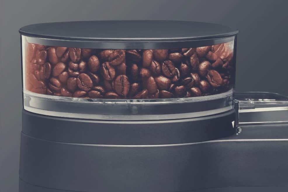 A close up of a coffee machine bean hopper