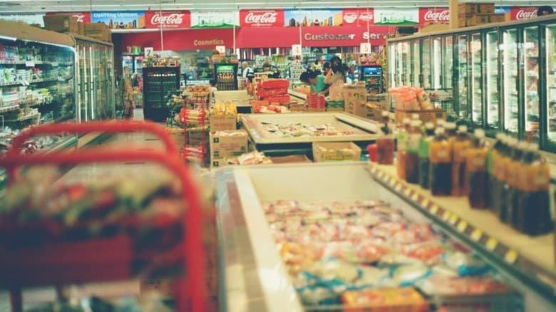 a wide shot of supermarket aisles