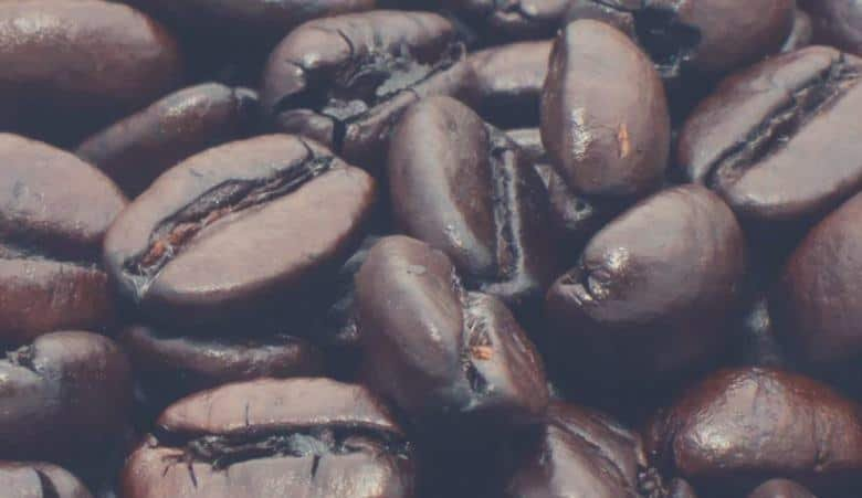 dark roasted coffee beans in a cup