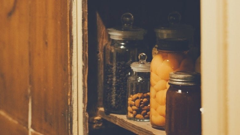 Various items on a shelf in a kitchen pantry