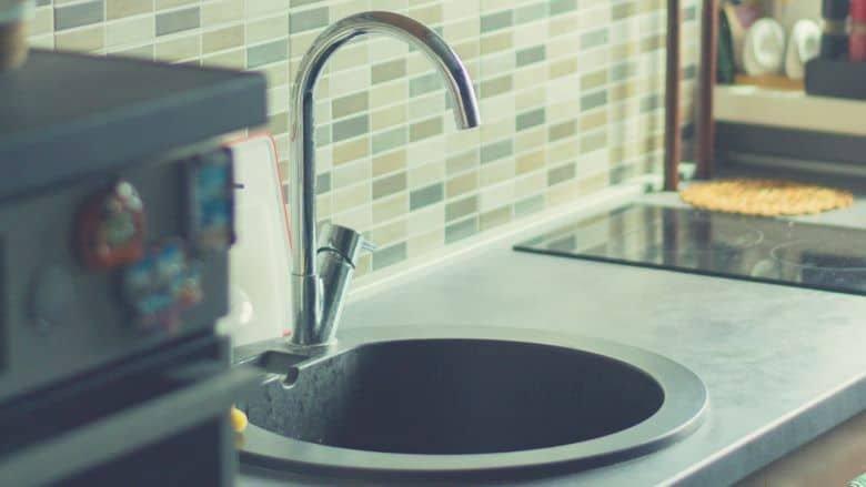 a kitchen sink with a gooseneck faucet