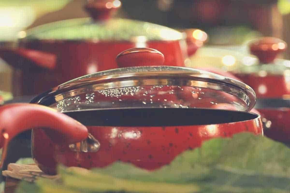 A close up shot of Paula Deen Signature cookware in red