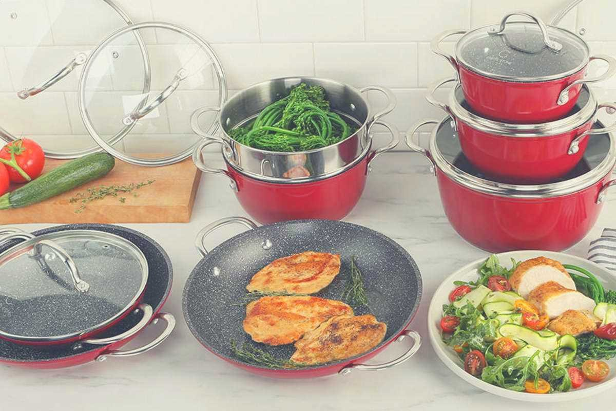 A selection of Curtis Stone cookware items with different food types