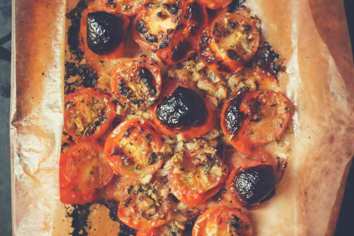 Burned tomatoes lying on a sheet of baking parchment