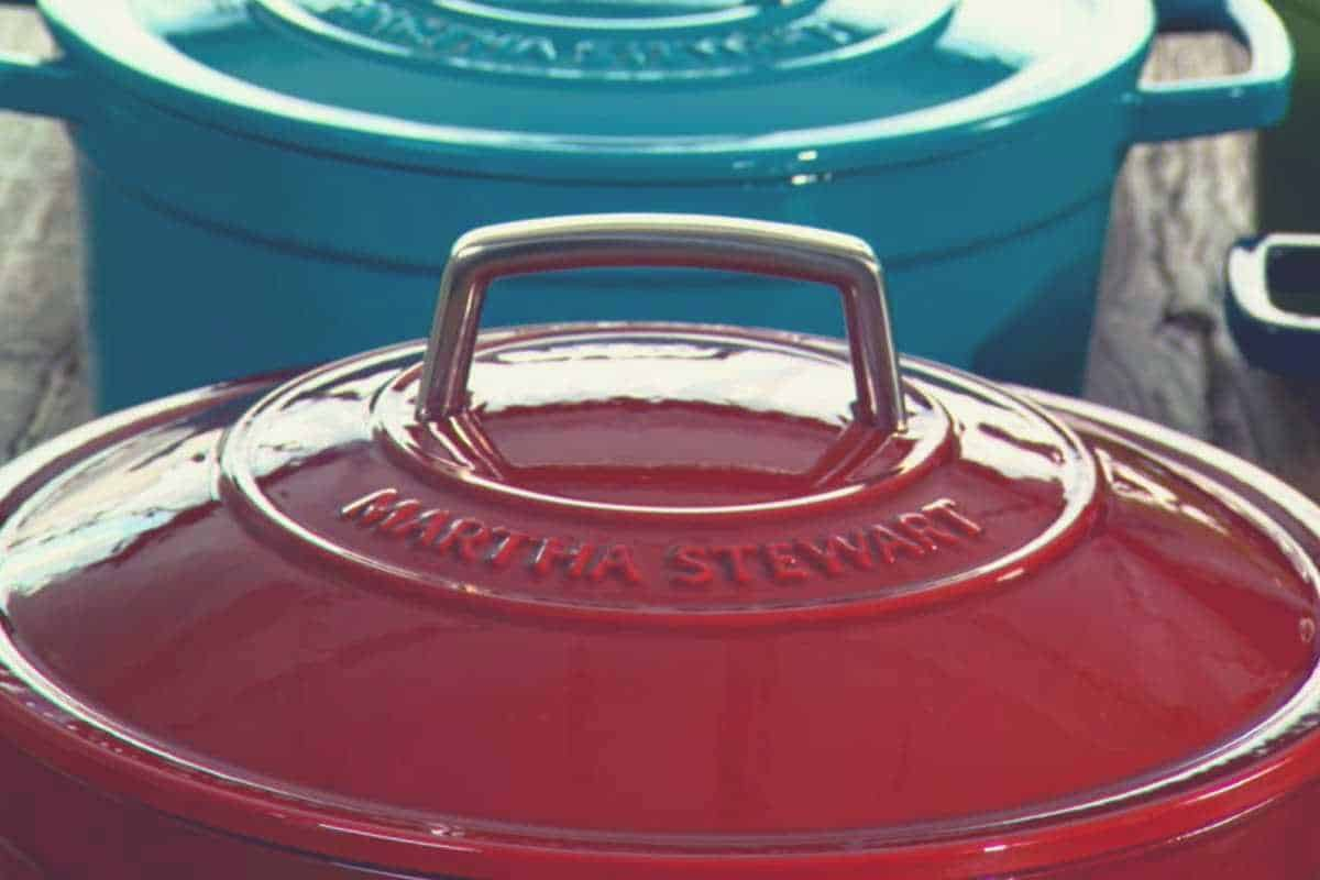 A close up view of a blue and red Martha Stewart dutch oven
