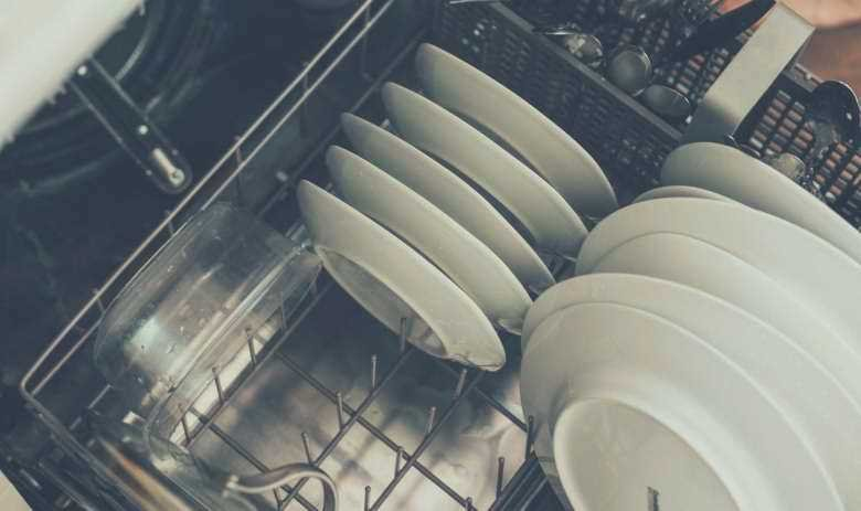 A top down view of plates sitting in a dishwasher